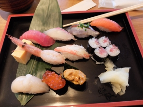 Sushi! Lots of different fish that I don't know the name of but including raw prawn and sea urchin (orange goop)